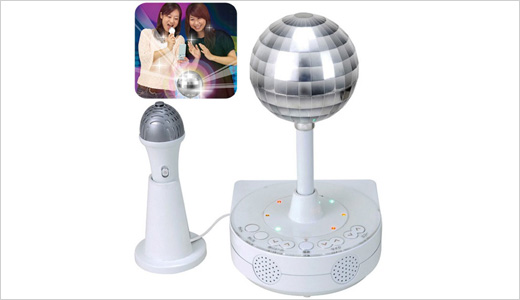 The Sega Disco Karaoke Machine has built-in mic and speakers. This machine connects to database of 43,000 song through cellphone, but only supports special karaoke-enabled mobiles in Japan. Other thing that you will like most is the light-up mirrored disco ball. Read